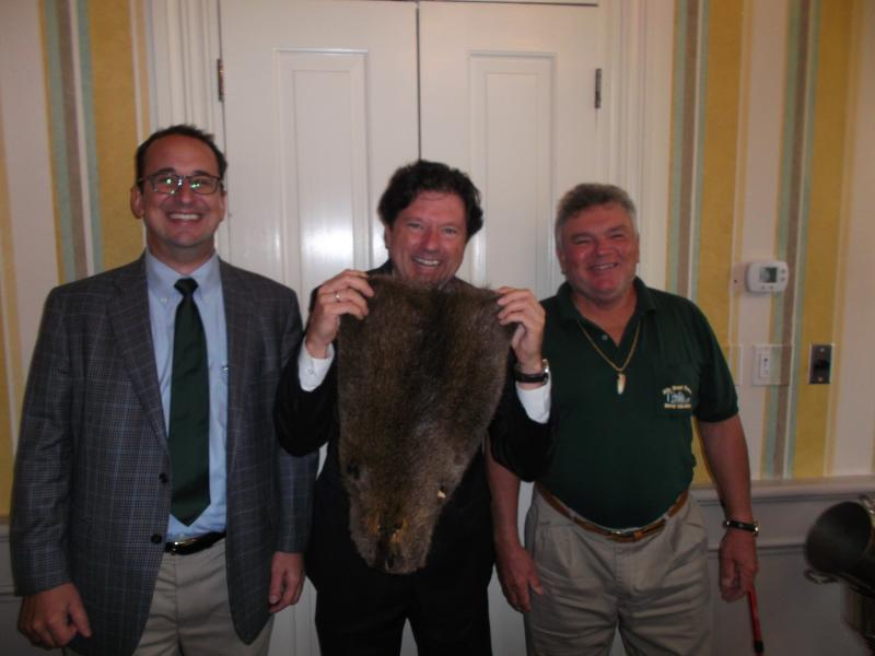 Hansel Haran, Peter Ricchuiti (with nutria pelt) and Arthur Matherne.