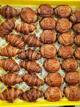 Croissants await delivery to stores inside theLa Boulange Pine Street baking facility in San Francisco, California. This facility bakes pastries and breads for all of the La Boulange restaurants in the San Francisco Bay Area.