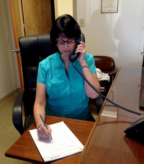 Ellen Katz speaks to a client on the phone.