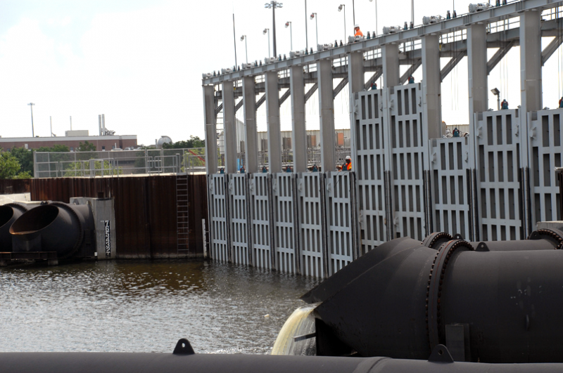 Army Corps of Engineers personnel testing the temporary outflow canal pumps and surge gates in 2009.