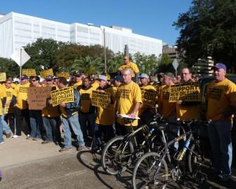 Firefighters protested outside New Orleans City Hall before the start of Friday's budget hearings, which looked at the Fire Department's budget and under-funded pension.