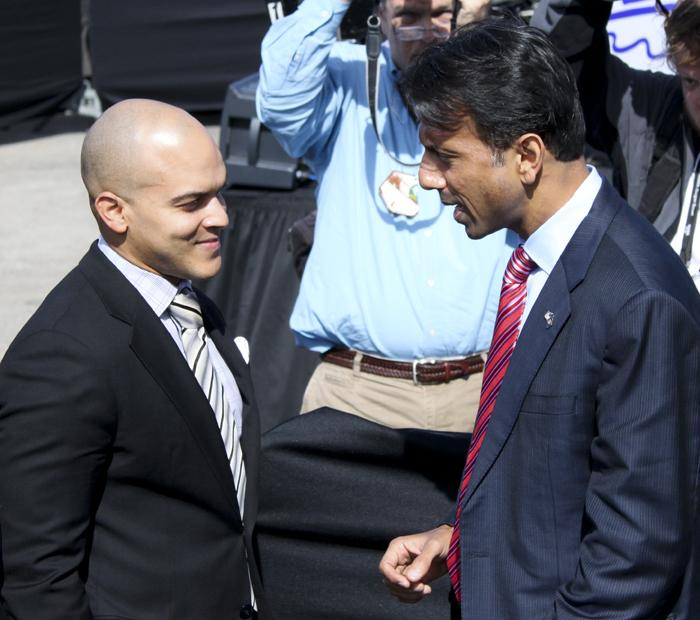 Trumpeter Irvin Mayfield speaks to Governor Bobby Jindal before the speech by President Barack Obama.