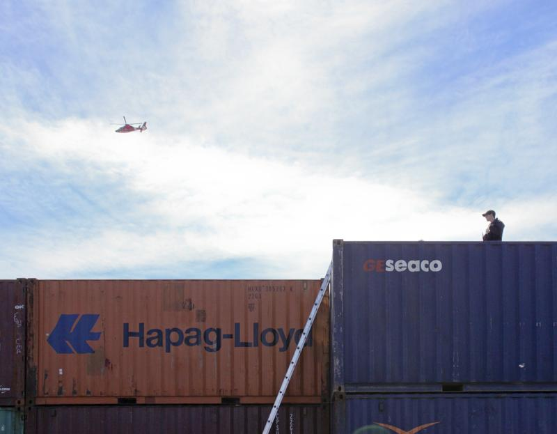Security was tighter than usual throughout the Port facility, including Coast Guard helicopter flybys and snipers stationed atop nearby shipping containers.