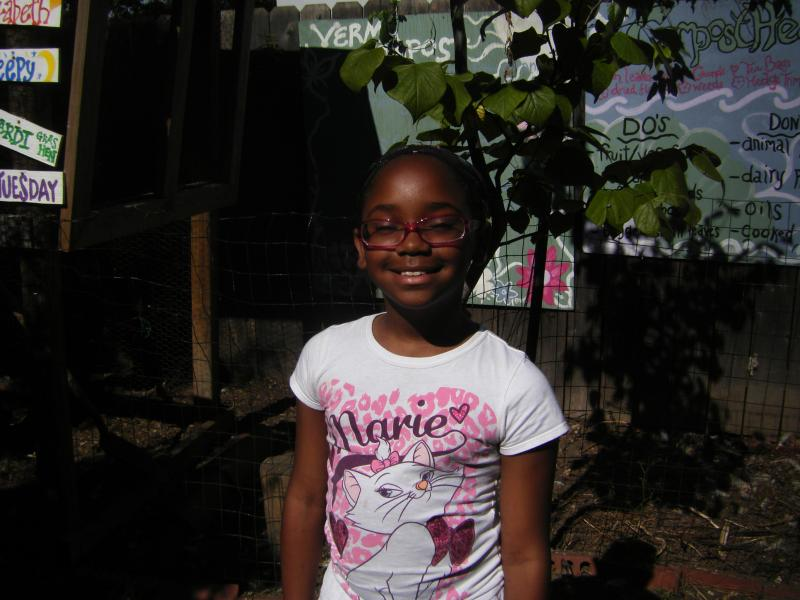 Crisean Mitchell in her school's community garden.