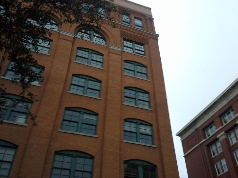 The window where officials determined Lee Harvey Oswald fired three shots. That window — second to the top on the right side — is the focal point of the Sixth Floor Museum now on the top two floors.