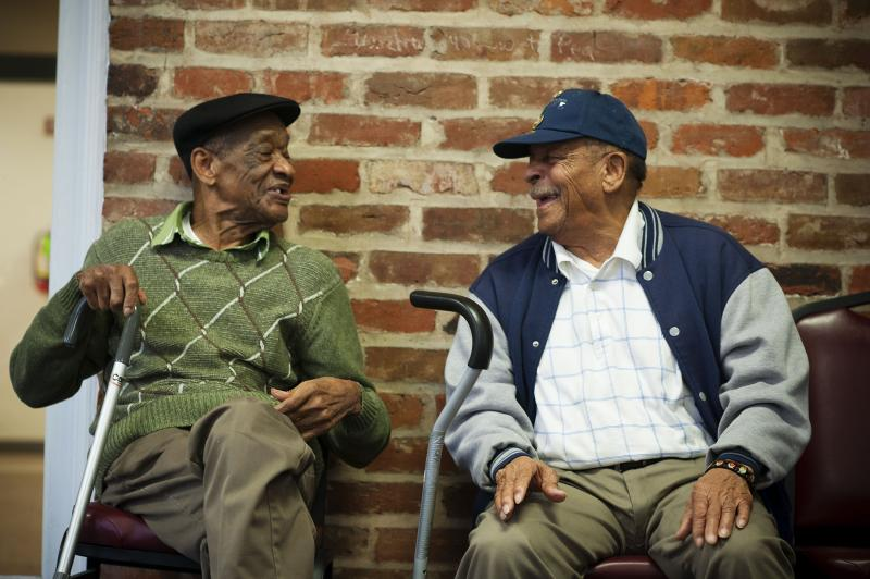 Two gentleman in the Adult Day Health Care at Kingsley House have a chat.