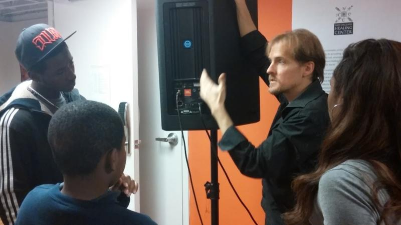 Matthew Shilling, of the New Orleans Youth Sound Experience, explaining to students how speakers work.