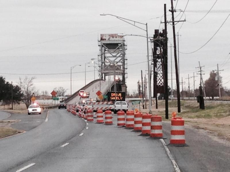 State transportation department workers restrict traffic on the Belle Chasse Bridge Tuesday morning.