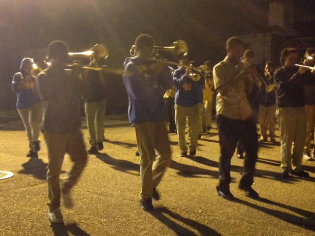 Landry–Walker High School students practicing for their first combined Mardi Gras parading season.