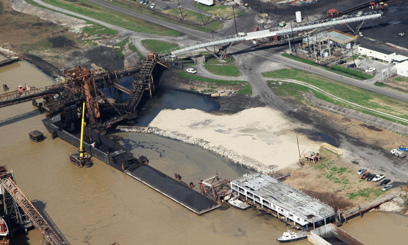 Coal and petroleum waste leak into the Mississippi River from the United Bulk Terminal facility in Plaquemines Parish on Feb. 18. A consortium of environmental groups sued the facility Tuesday morning.