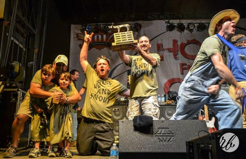 New Orleans chefs including Aaron Burgau, Nathaniel Zimet, Dan Esses and Bart Bell celebrate a win in last year's Hogs for the Cause competition.