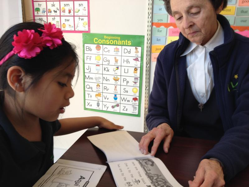 First grader Melanie reads identical books in English and Spanish.
