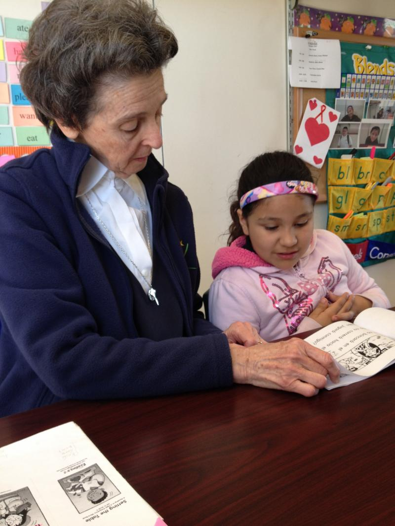 Josabeth, a first grader, reads high frequency words with her ESL teacher, Sister Wood.