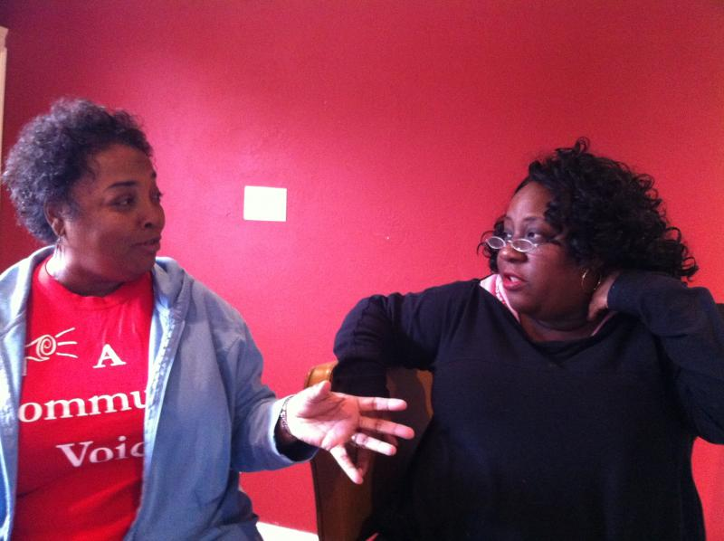Vanessa Gueringer and Kim Ford of the Holy Cross neighborhood association discuss the proposed high-rise development in Holy Cross.