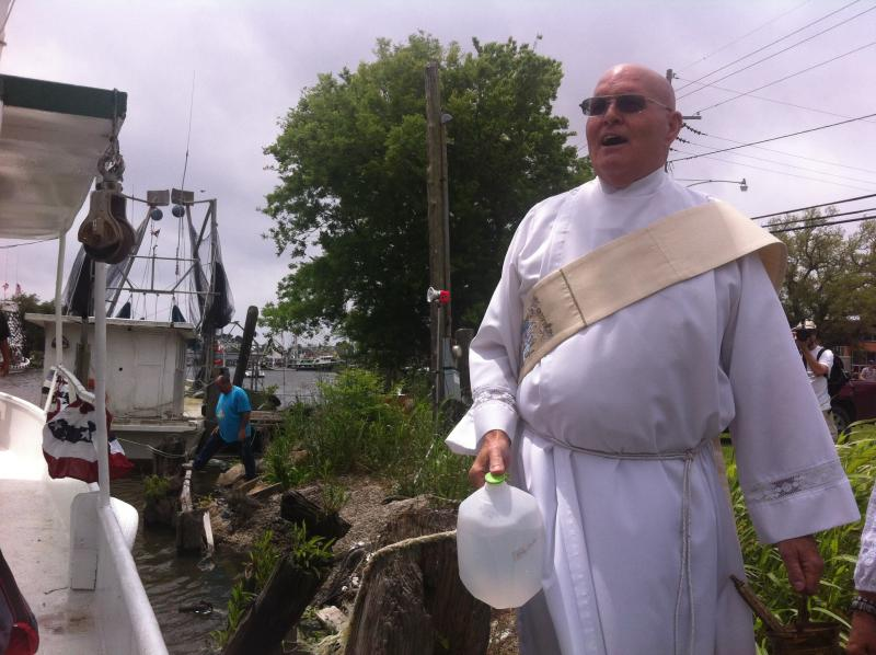 Deacon Lloyd Duplantis prepares to bless the boats in Chauvin. Duplantis is originally from the area, but had never led the ceremony.
