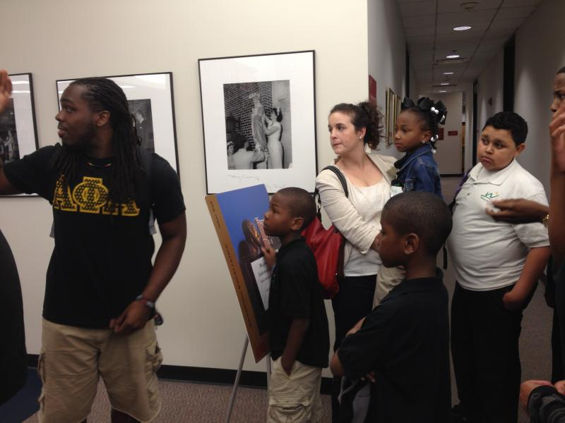 Stephen Lee, a senior studying philosophy at Loyola, gives a tour to students from Andrew Wilson School