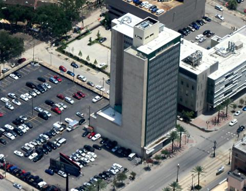 Aerial view of the former Texaco building on Canal Street, now home to a mixed-use development for seniors.