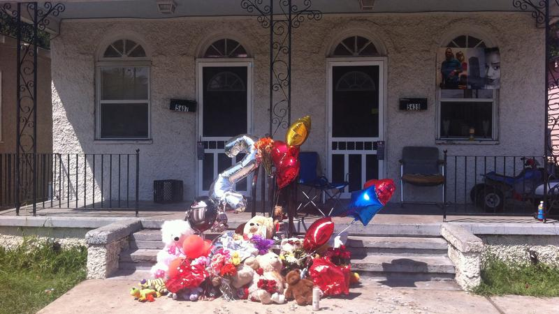 Family members and neighbors of the victims have put up a memorial in front of the house where the shooting took place.