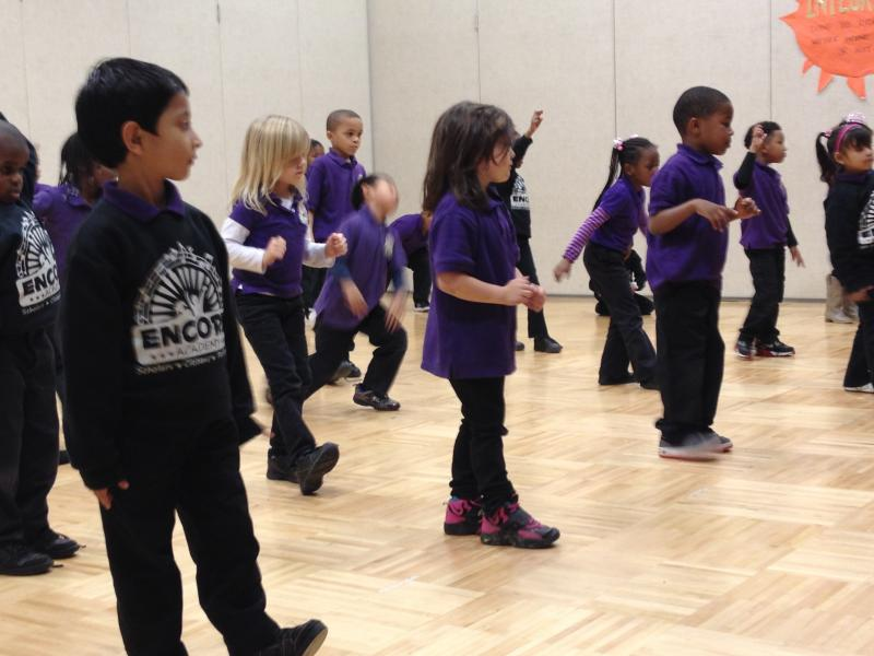 A class of pre-kindergarteners learn tap dancing.