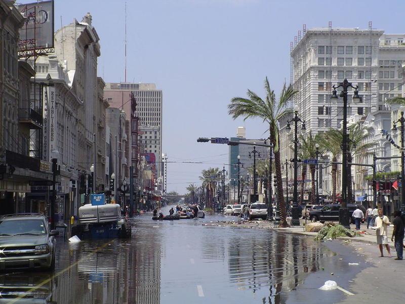 A photo taken in the immediate days after Hurricane Katrina shows floodwaters on Canal Street, crossing into the French Quarter.