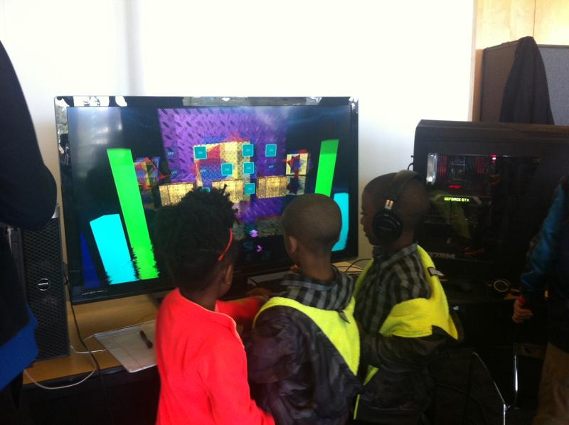 Young people explore the innovations on display at the Mini Maker Faire.