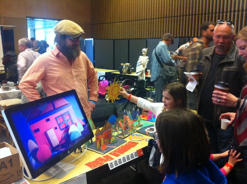 Graphic designer Dan Haugh demonstrates stop-motion animation at the New Orleans Mini Maker Faire.