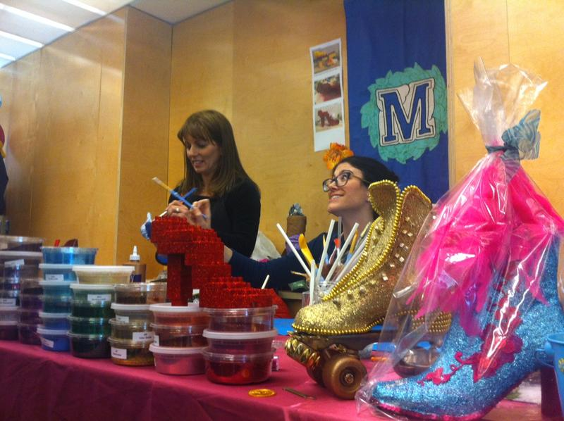 The Krewe of Muses demonstrates how to make one of their coveted glittered shoes in the craft room of the New Orleans Mini Maker Faire.
