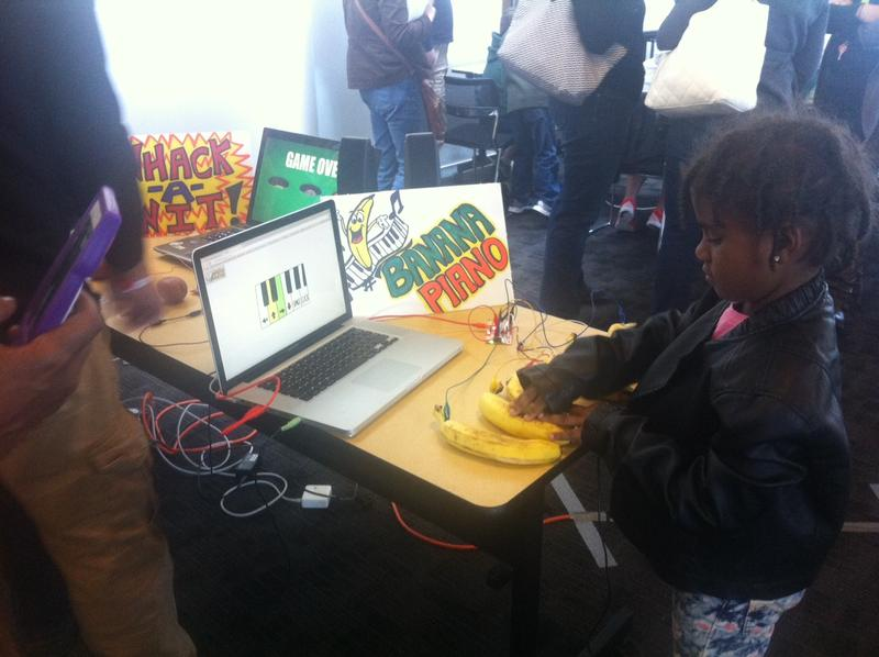 """Playing the """"banana piano"""" at the New Orleans Women In Technology (WIT) table."""