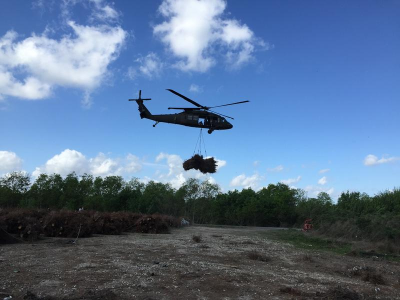 A National Guard black hawk lifts a bundle and heads towards Joe Madere marsh unit in Bayou Sauvage
