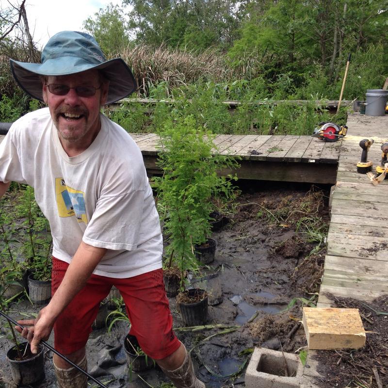 Gary Shaffer repairs Wetland Resource's tree nursery.