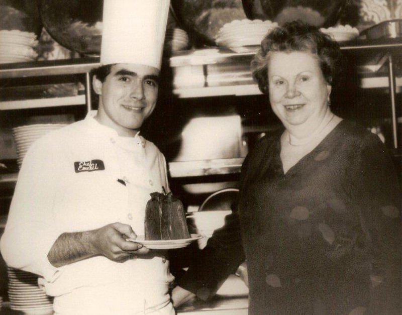 The legendary Ella Brennan in the kitchen with Emeril Lagasse.