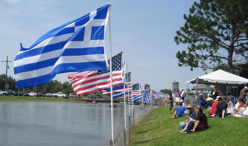 Greek and American flags line Bayou St. John outside of Holy Trinity Greek Orthodox Cathedral in New Orleans.