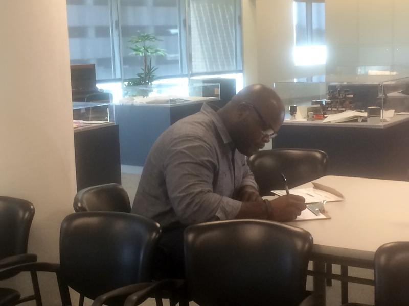 Earl Benjamin applies for a marriage license at the  Jefferson Parish Clerk of Court's office.