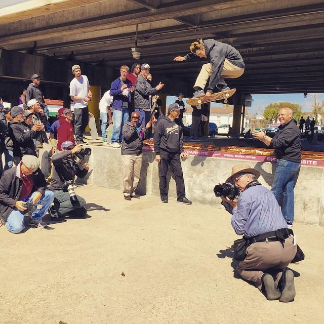 A skateboarder does an ollie over a 40 foot reuben made by Stein's deli for the 'rueben cutting' of Parisite Skatepark as Mayor Mitch Landrieu stands by.