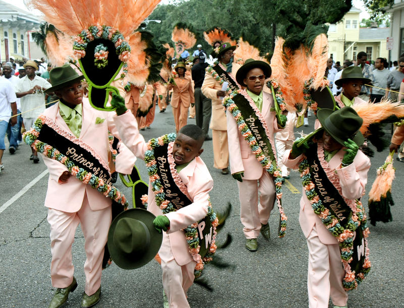 Undeterred by the devastation, second line clubs returned to New Orleans a few months after the flood, determined to uphold the city's cultural traditions. This photo is of the 2009 Prince of Wales second line parade.