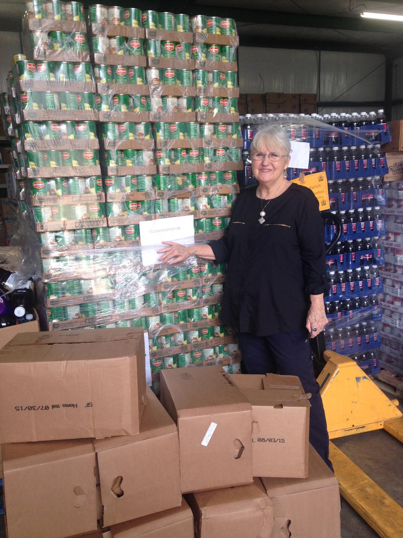 Executive director of Our Daily Bread Food Bank in Hammond, Myrna Jordan, stands in front of pallets of food in the warehouse. The food is distributed to 25 sites throughout the Tangipahoa Parish every week.
