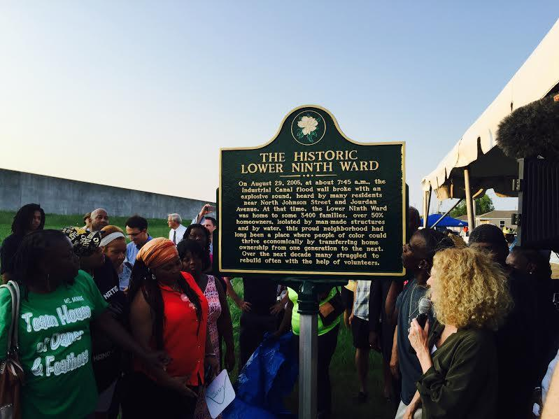 Residents of the Lower 9th Ward attend an unveiling a plaque marking the location of the levee break.