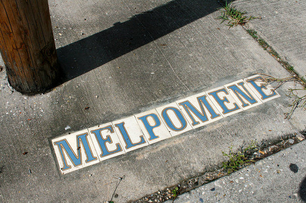 How do New Orleanians pronounce the street name Melpomene?