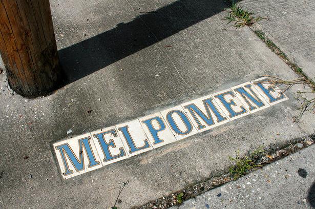 How do New Orleanians pronounce the street name Melpomene?