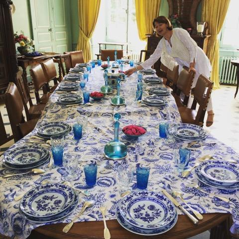 "Marie Saint Bris sets the table for ""le dîner bleu"" in the dining room of her family's Château Beauchêne in France's Loire River Valley."