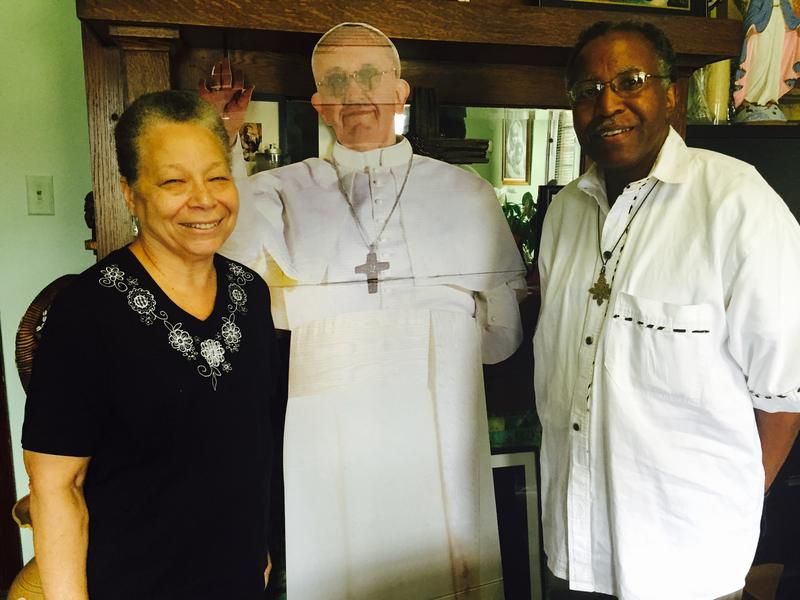 Deacon Allen Stevens of St. Peter Claver Church poses with a cardboard cutout of Pope Francis.