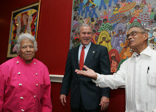 President George W. Bush visits the restored Dooky Chase Restaurant in 2008 with Leah Chase, left, and Dooky Chase, right.