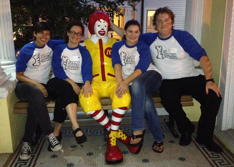 A group of Funny Bones Improvisers pose outside of the Ronald McDonald House in New Orleans, one of the many locations they visit each month.