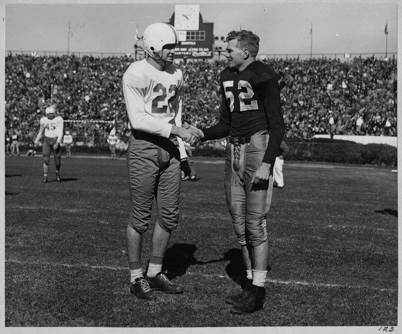 January 1, 1948: Texas Quarterback Bobby Layne #22 visits with Alabama's Harry Gilmore #52. Layne received the Sugar Bowl's very first MVP award, and was reputedly caught drinking hurricanes out of the trophy in the French Quarter that night.