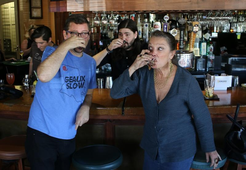 Chris Jay, bartender Aulden Morgan and Poppy Tooker sample the Carolina Reaper-infused vodka at Zocolo Neighborhood Eatery in Shreveport.
