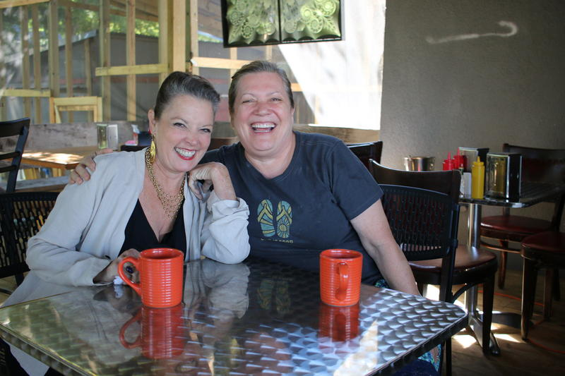 Poppy Tooker and Carolyn Simmons, winner of the James Beard Foundation's Better Burger Project, on the patio of Blue in Shreveport.