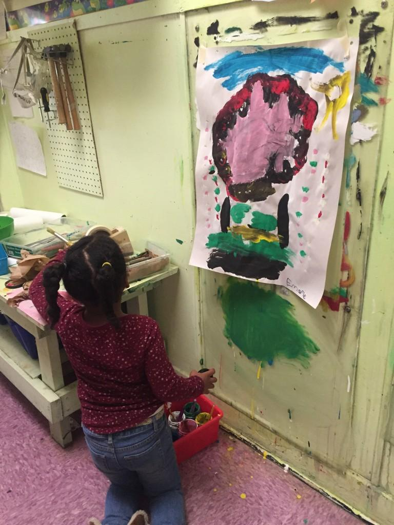 Kindergartner Emarie puts paint supplies away at Central Park School for Children in Durham, North Carolina. The charter school promotes a hands-on, project-based curriculum.