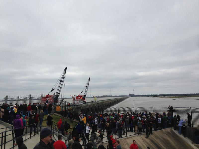 The Army Corps of Engineers used small cranes to slowly begin opening up the Bonnet Carre Spillway.
