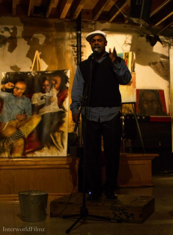 Gian Smith recites poetry at a local poetry slam.