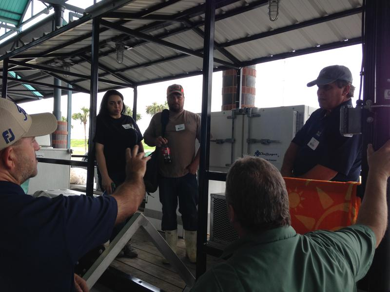 Thomas Hymel, a seafood specialist with the LSU AgCenter and Sea Grant, talks with shrimpers about freezer technology at the Louisiana Fisheries Forward Summit.
